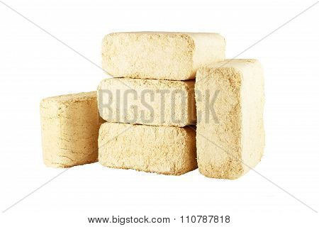 Compressed sawdust briquettes isolated on white background