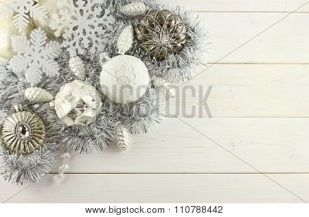 Christmas decoration - white and silver balls, silver cones, white snowflakes, silver garland