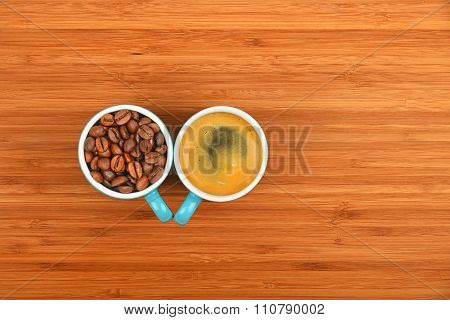 Two Coffee Cups Espresso And Beans Over Wood Background