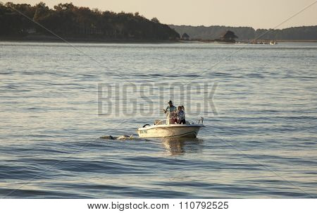 HILTON HEAD, SOUTH CAROLINA-NOVEMBER 28, 2015: Unidentified boaters take pictures of bottlenose dolphins of the coast of Hilton Head, South Carolina.