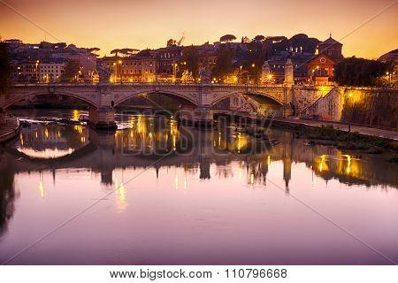 Bridge With Tiber River View At Dusk Panorama in Rome