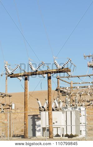 Electrical power distribution system comprising power poles, insulators, wire or cable and transformers.