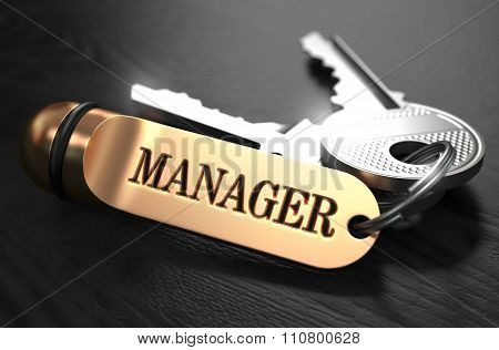 Manager - Bunch of Keys with Text on Golden Keychain.