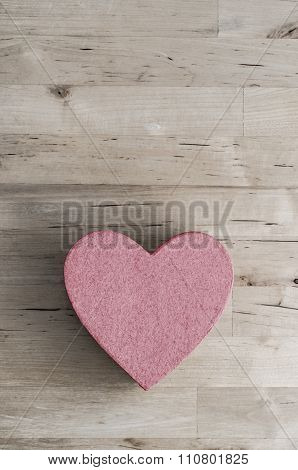 Pink Heart Shaped Box On Wood Plank Table From Above