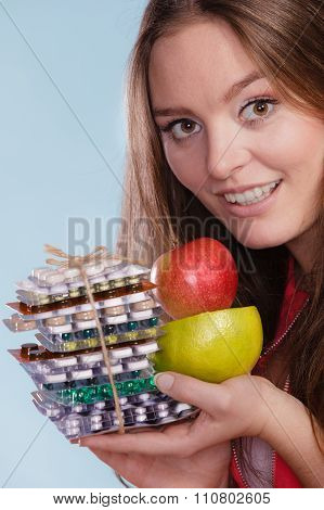 Woman Holding Pills And Fruits. Health Care
