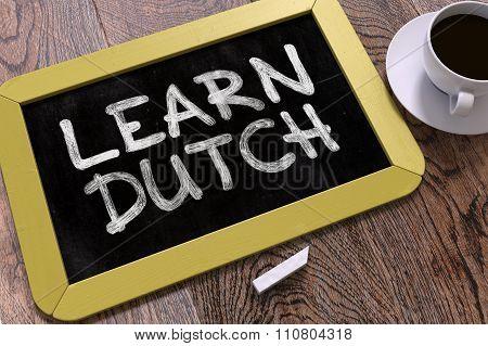 Learn Dutch Handwritten by white Chalk on a Blackboard.