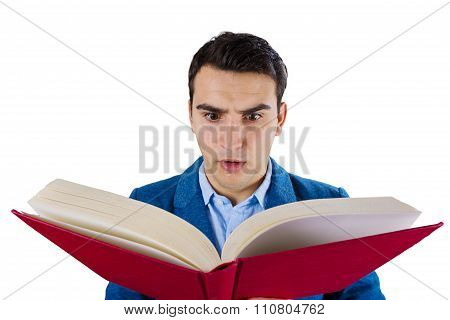 Surprised man holding opened book