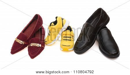 Three Pairs Of Shoes For Dad Mom And Son On A White Background As Family Concept