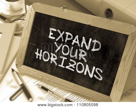 Expand Your Horizons. Motivation Quote a Blackboard.
