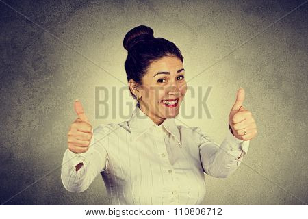Success business woman excited giving thumbs up.