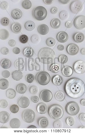 Many Buttons Assorted On White Background