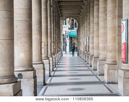 Stone Columns And Tiled Floor Arcade Outside Comedie Francaise, Paris