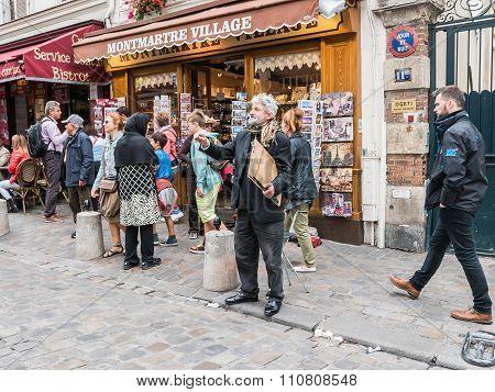 Bearded Portrait Artist Gestures To Unseen Friend Across Montmartre Street, Paris
