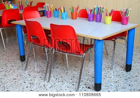Classroom With Desks And Small Red Chairs