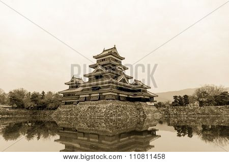 Masumoto Castle , Black Palace For War In Autumn At Nagano Province In  Japan With Clear Sky Golden