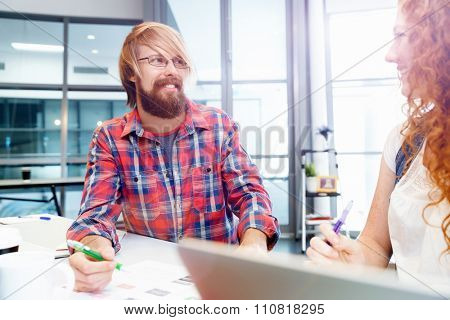 Two co-workers working together in office