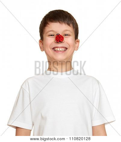 boy with ladybug look on nose and make faces, teenager fun portrait closeup