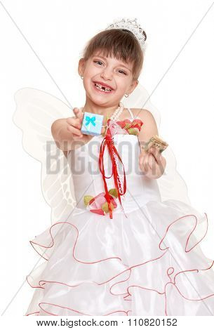 tooth fairy girl dressed in white with wings give gift and money