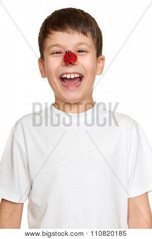 boy with ladybug onface, teenager fun portrait closeup