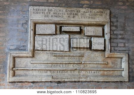Old Sign On The Wall Of Ancient Building On Cavour Square In Rimini, Italy