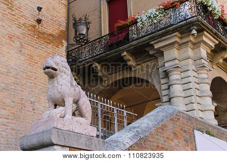 Ancient Building With Old Stone Statue On Cavour Square In Rimini, Italy