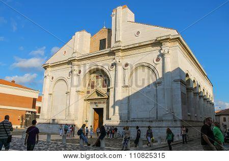 Tourists Walking Near The Ancient Malatestiano Temple (il Tempio Malatestiano) In Rimini, Italy