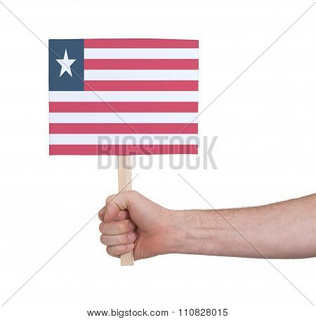 Hand Holding Small Card - Flag Of Liberia