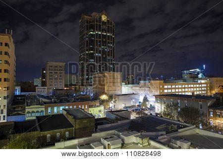 Urban rooftop view of Raleigh, North Carolina at night