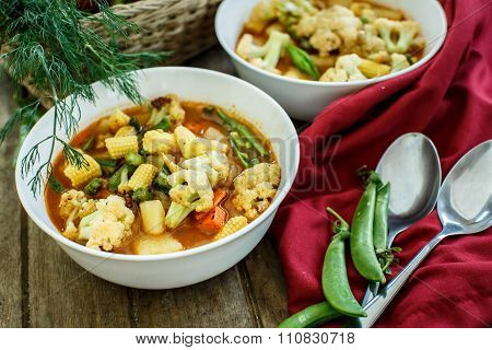 Steamed Vegetables In A Bowl On Wooden Table