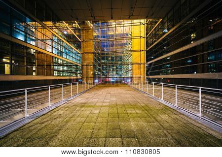 Walkway And Modern Building At Night, At La Défense, In Paris, France.