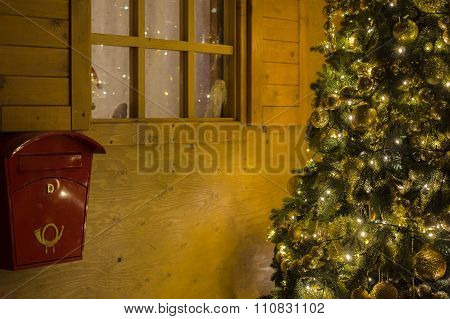 Santa Claus House With Letterbox And Decorated Christmas Tree
