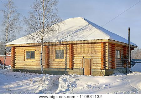 Wooden Country Small House Of Timber Stained Yellow, Snowy Winter, Sunny Day.