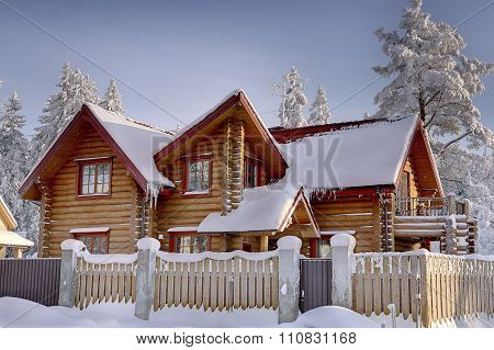 Wooden Cottage Of Stained Timber, Snowy Woods In Winter.