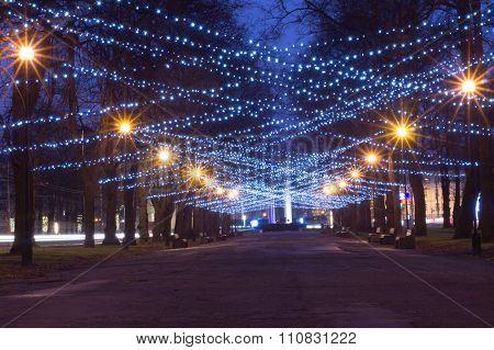 New Year And Christmas Festoon Illumination On City Alley