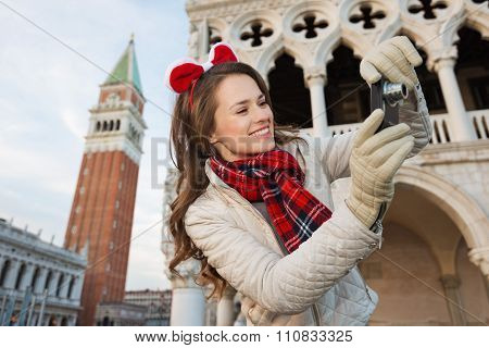 Happy Woman Tourist Taking Photos Of Sights In Christmas Venice