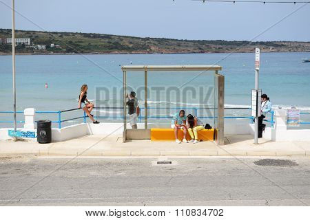 Mellieha, Malta - April 20: The Bus Station And Tourists Near Beach On April 20, 2015 In Mellieha, M