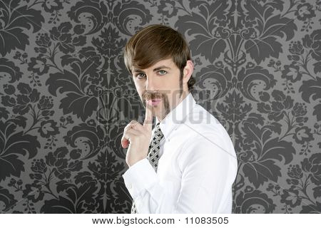 Silence Finger Gesture Retro Businessman On Wallpaper