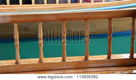 Wooden boat rail close up