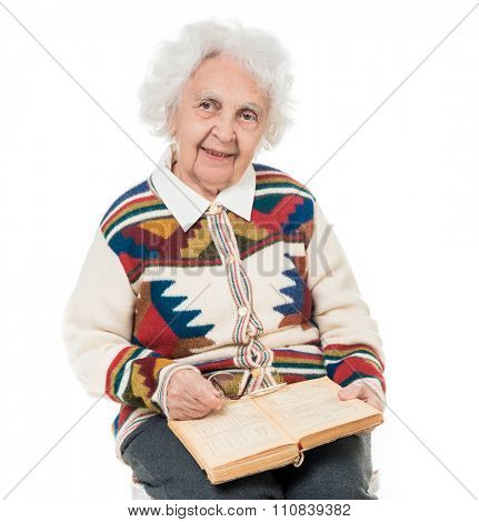 elderly woman flipping an old book isoalted on white background