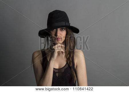 Beautiful girl with black hat.