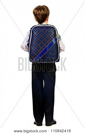 Full length portrait of a boy in a suit standing with schoolbag. Fashion kids. Education. Isolated over white.