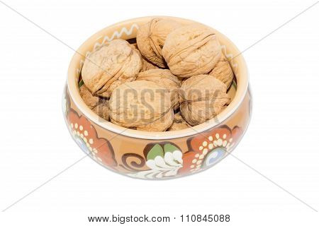 Bowl With Walnuts On A White Background