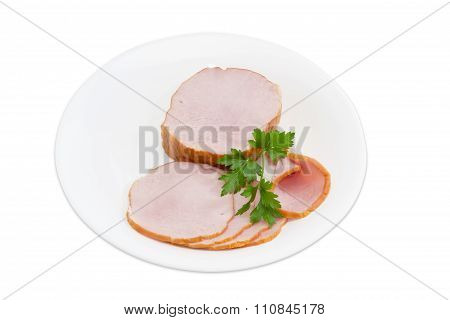 Pork Loin And Sprig Of Parsley On A White Plate