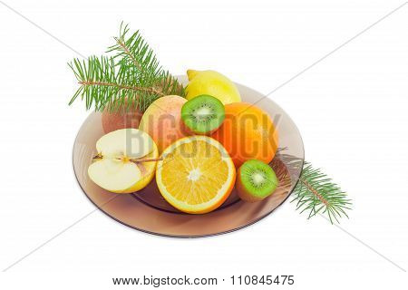 Different Fruits On A Glass Dish And Fir Branches
