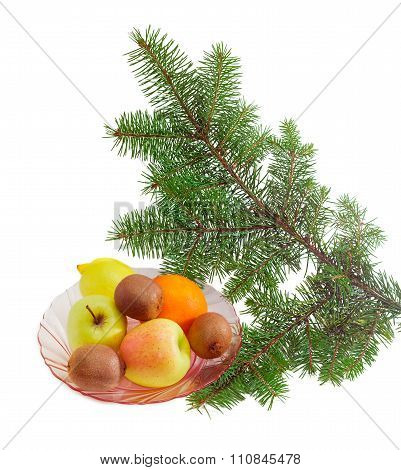 Different Fruits On Dish And Fir Branch
