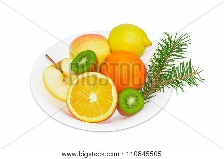 Different Fruits On A White Dish And Fir Branch
