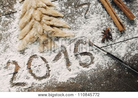 Christmas Tree With Flour On The Wooden Table