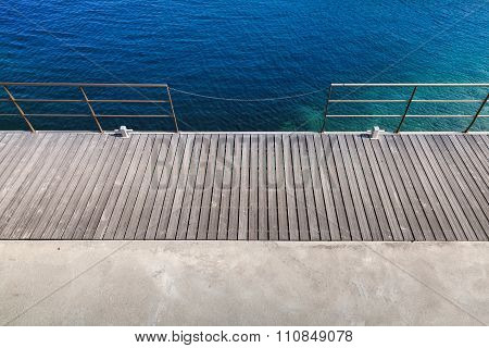 Wooden Pier With Metal Railing, Top View