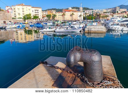 Big Rusted Mooring Bollard In Old Port Of Ajaccio