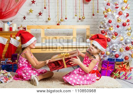 Girl Wants But Can Not Pick Up A Christmas Gift From The Other Girls